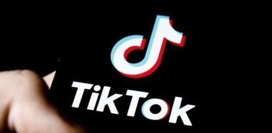 Threatened young woman with tik tok