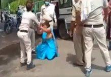 police beats woman
