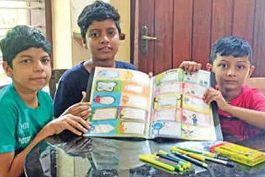 Vaccine Challenge; Three students make name slips to raise money
