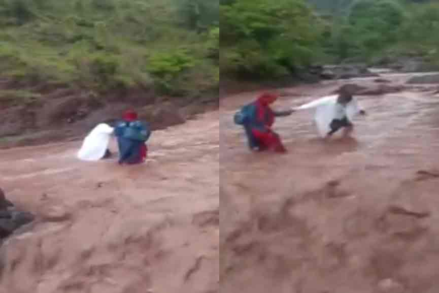 Health workers cross the river to deliver the vaccine