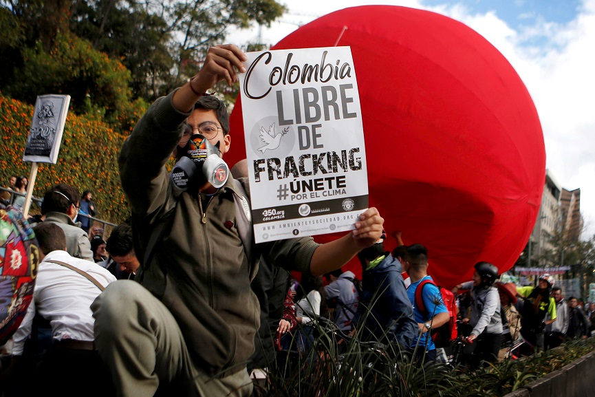 An activist holds a poster